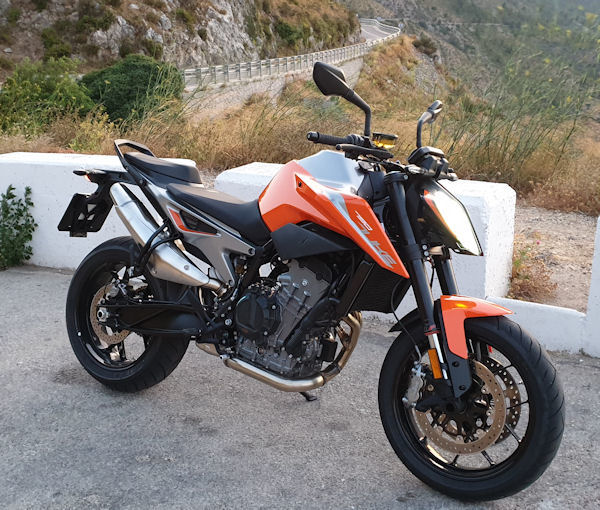 KTM 790 Duke with mountain roads in the background