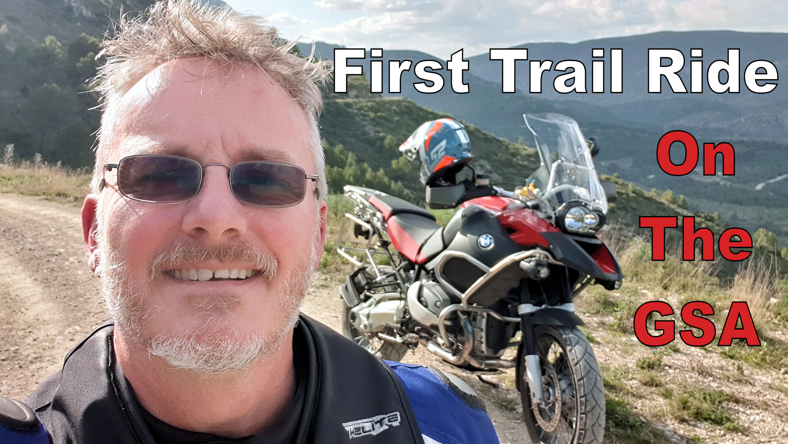 Chris from Bikers España stood with a BMW R1200GSA in the mountains